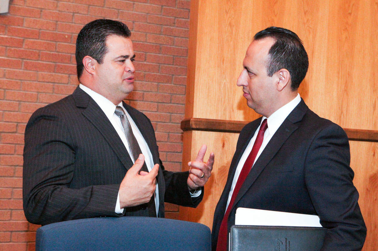 Mayor Pro Tem Homer Jasso, Jr., left, reviews strategies with City Manager Ramiro Garza, Jr.